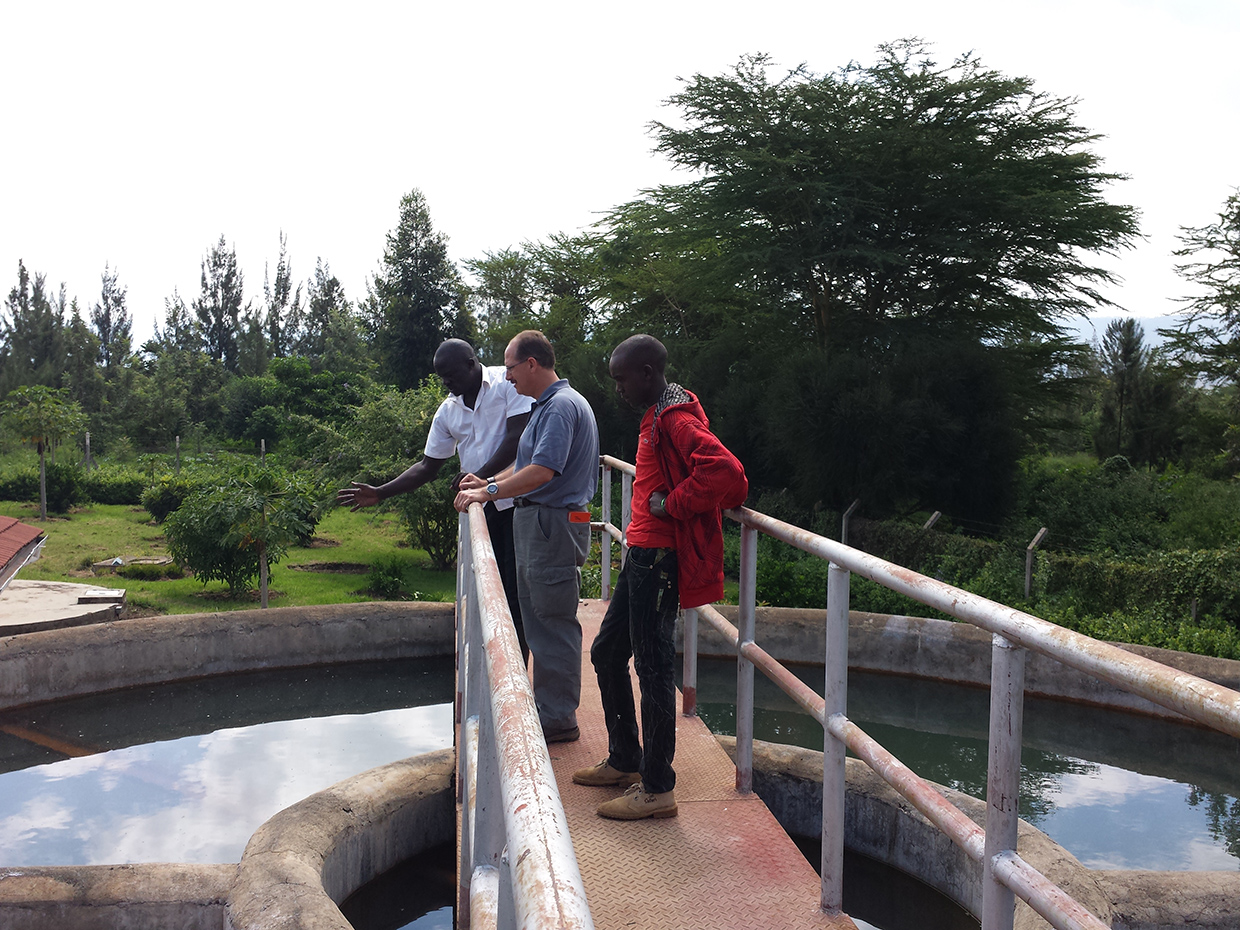 Clifford and Solomon at Ewuaso Water Treatment Facility inspecting holding tanks