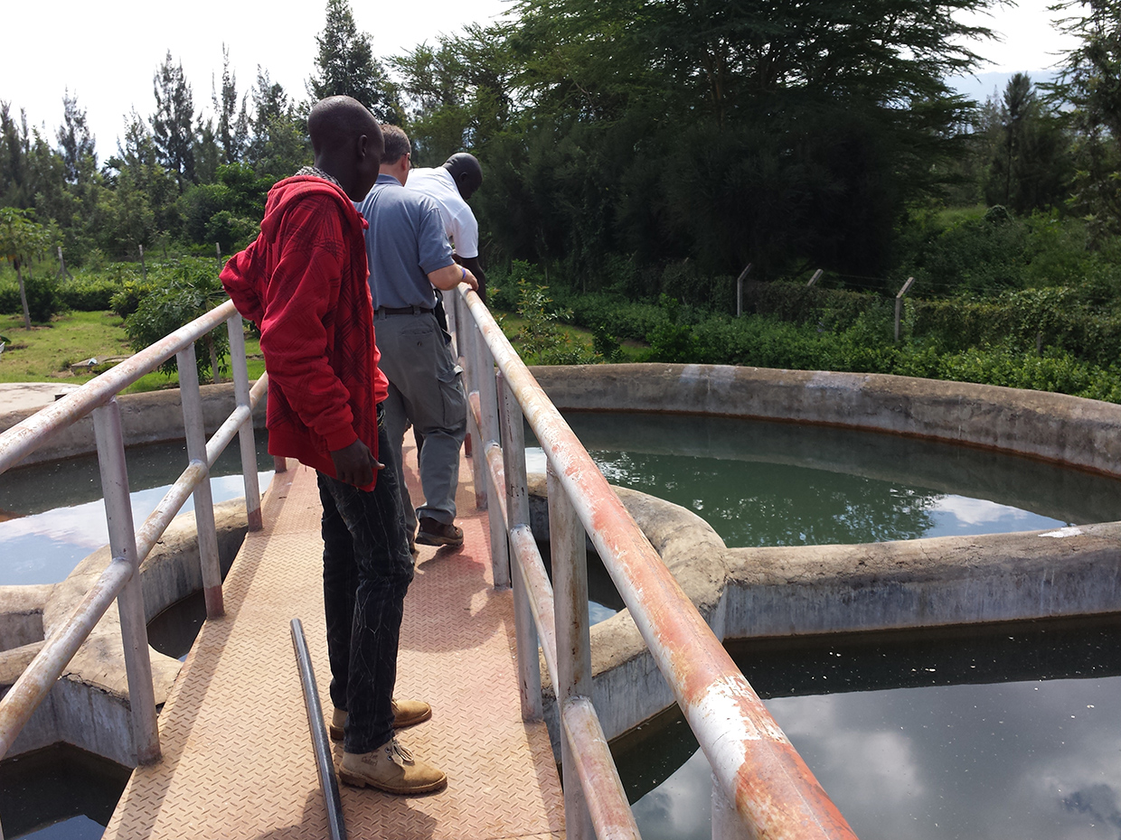 Clifford and Solomon at Ewuaso Water Treatment Facility looking at holding tanks