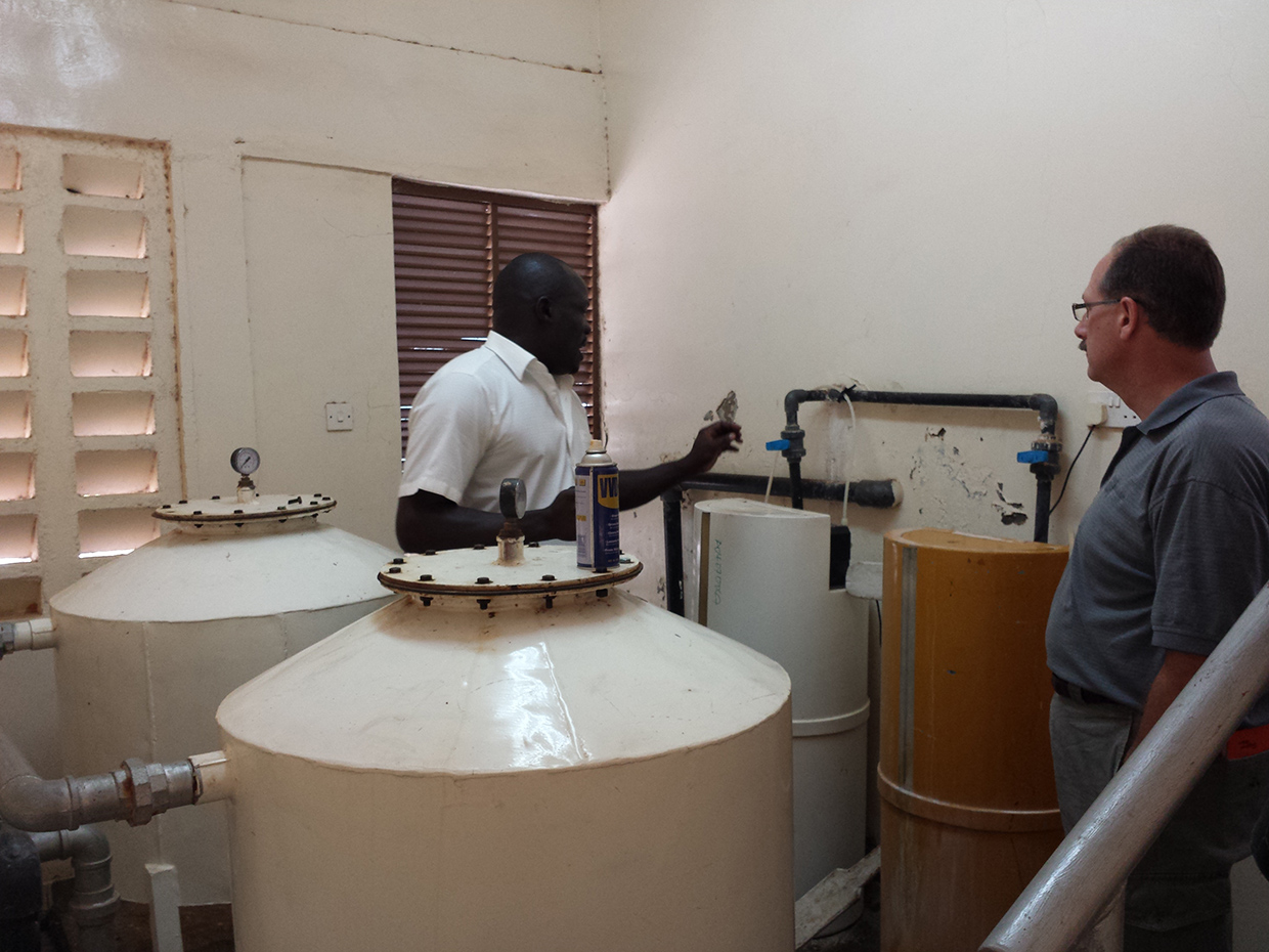 Ewuaso Water Treatment Facility manager explaining purification system to Cliff
