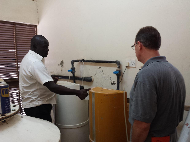 Ewuaso Water Treatment Facility manager explaining purification system