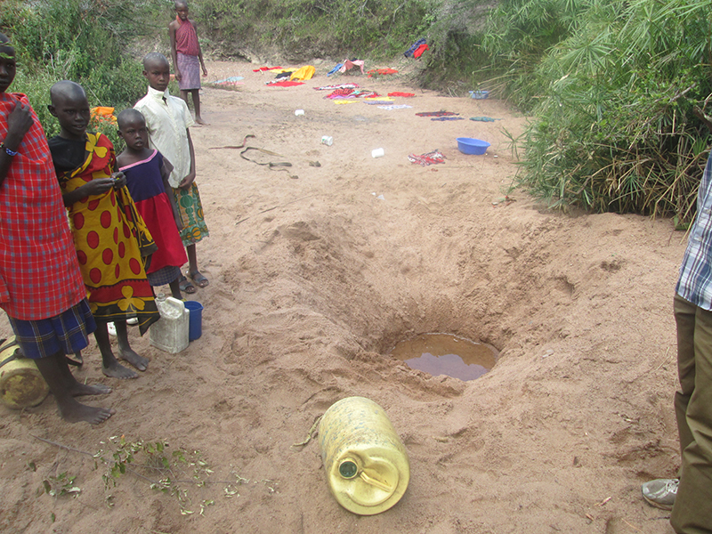 Maasai-children-and-young-women-at-watering-hole-in-Kenya
