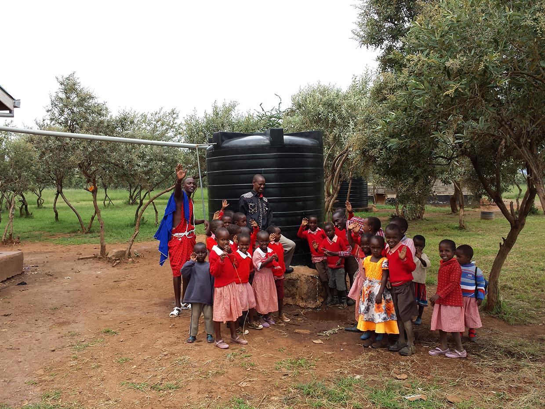 Namuncha-Child-Development-Center-children-posing-in-front-of-second-water-rainbarrel-2